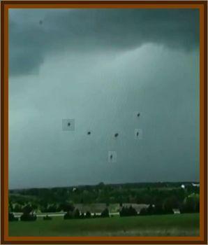 5 Or 6 Shiny Circular Objects Near Storm